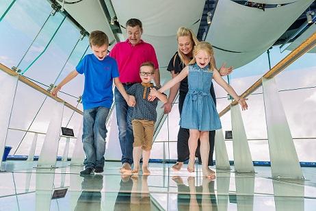 Family walking on glass floor